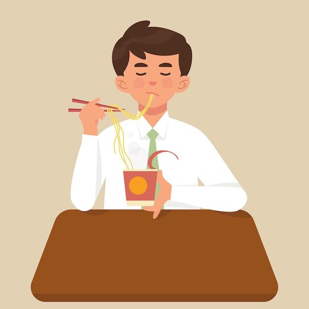 Jeune travailleur mange une tasse de nouilles instantanées pour le déjeuner Vecteur Premium
