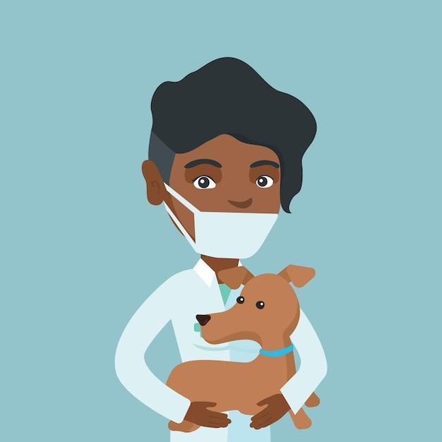 Jeune vétérinaire africaine avec chien dans les mains. Vecteur Premium