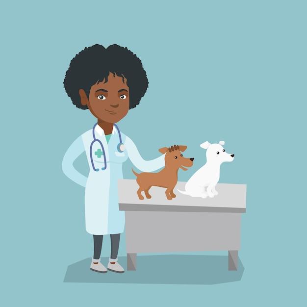 Jeune vétérinaire afro-américaine examinant des chiens Vecteur Premium