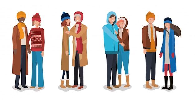 Jeunes couples avec des vêtements d'hiver Vecteur Premium