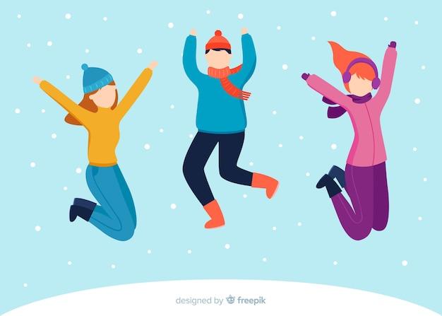 Jeunes gens portant des vêtements d'hiver sautant illustration design plat Vecteur gratuit
