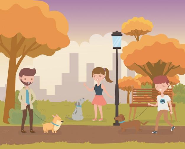 Jeunes avec mignonnes petites mascottes de chiens sur le terrain Vecteur Premium