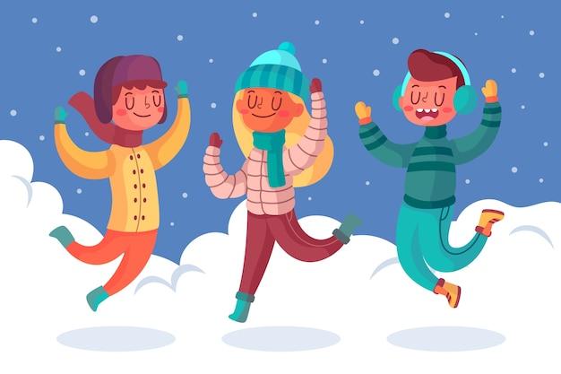 Jeunes Sautant Dans La Neige Vecteur gratuit