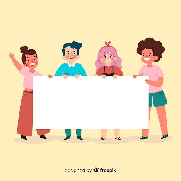 Jeunes tenant une bannière vierge Vecteur gratuit