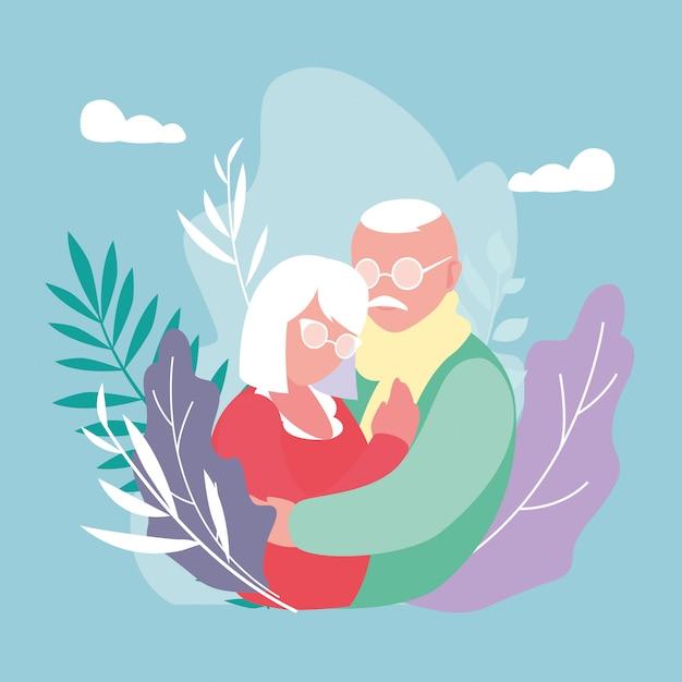 Joli couple âgé embrassé avec décoration de feuilles Vecteur Premium