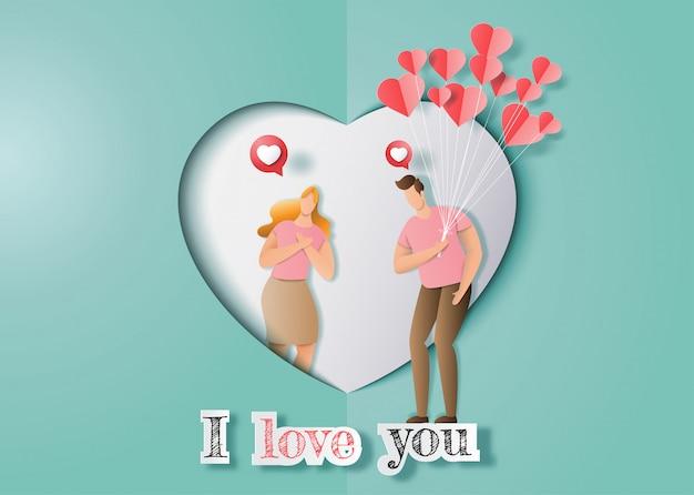 Joli couple amoureux, un homme tenant beaucoup de ballons de coeurs sur le point de donner à une fille. Vecteur Premium