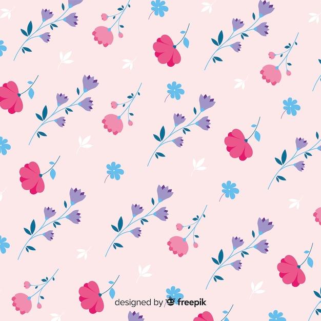 Joli motif de fleurs sur fond rose Vecteur gratuit