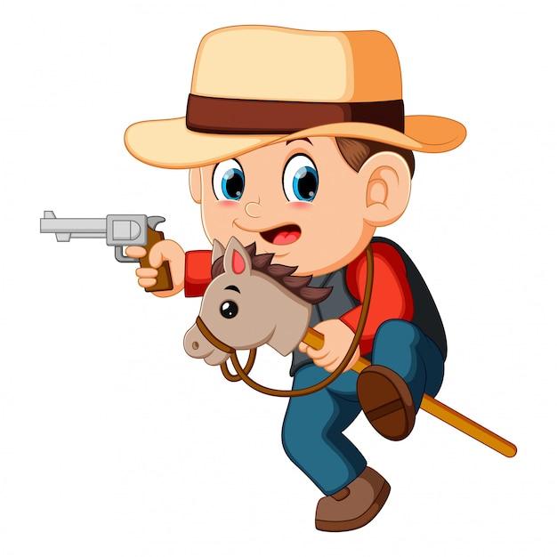 Joli petit garçon jouant avec un cheval sur un bâton et un fusil Vecteur Premium