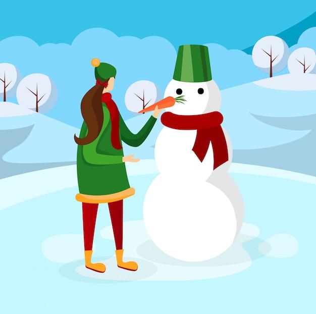 Jolie fille faisant bonhomme de neige sur fond d'hiver Vecteur Premium
