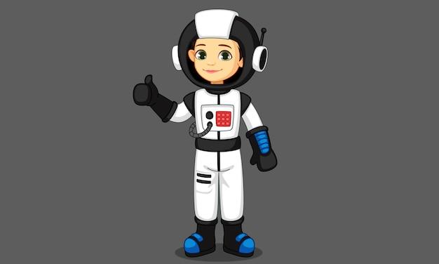 Jolie petite fille astronaute montrant le pouce Vecteur Premium
