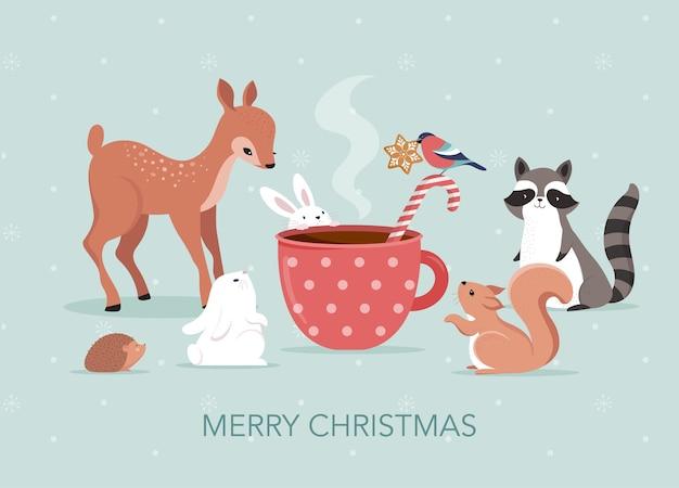 Jolie Scène De Noël Avec Cerf, Lapin, Raton Laveur, Ours Et écureuil Autour D'une Tasse De Chocolat Chaud Vecteur Premium