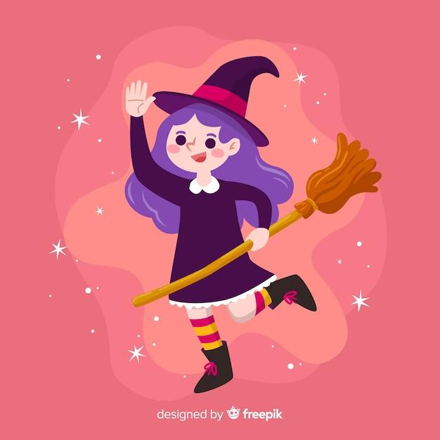 Jolie sorcière d'halloween sur fond rose Vecteur gratuit