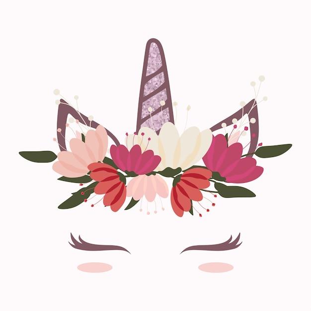 Jolie tête de licorne avec une belle couronne de fleurs Vecteur Premium