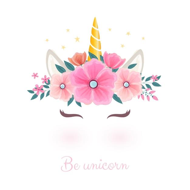 Jolie tête de licorne avec une couronne de fleurs. Vecteur Premium