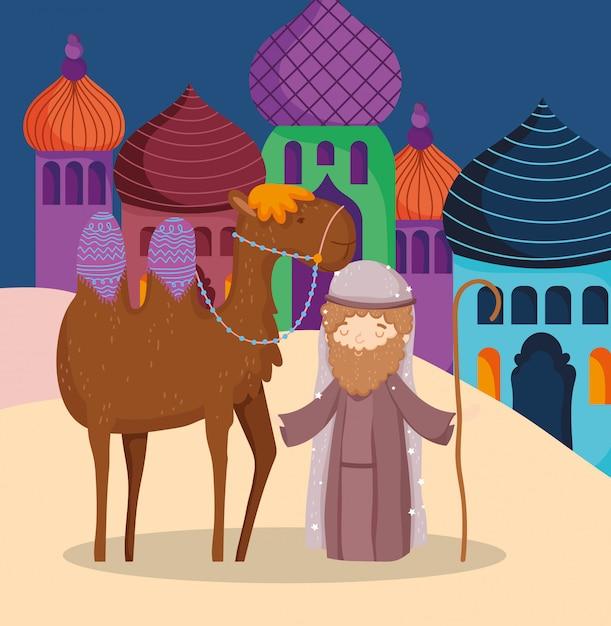 Joseph avec chameau dans la crèche du village, joyeux noël Vecteur Premium