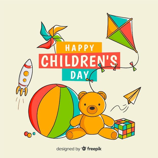 Jouets de jour pour enfants dessinés à la main Vecteur gratuit