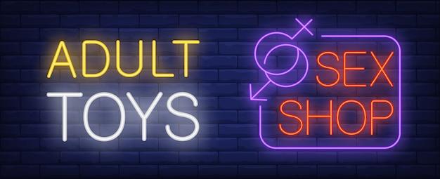 Jouets pour adultes en signe au néon sex-shop. symboles de genre se rejoignant dans le coin de l'enseigne. Vecteur gratuit