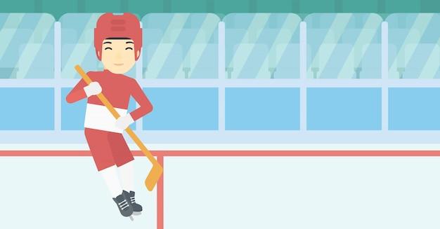 Joueur de hockey sur glace avec illustration vectorielle de bâton. Vecteur Premium