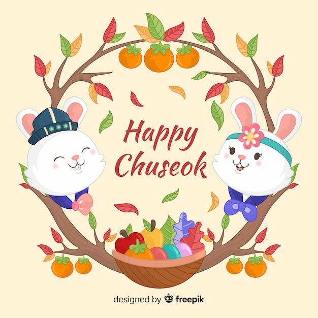 Jour de chuseok dessiné avec des lapins Vecteur gratuit