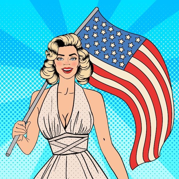 Jour de l'indépendance américaine. belle femme avec drapeau américain. pop art. Vecteur Premium