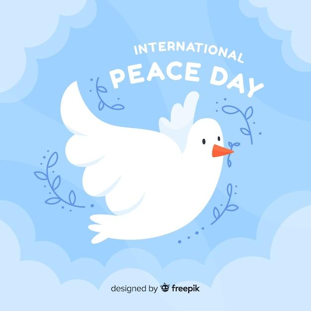 Jour de paix design plat avec une colombe Vecteur gratuit
