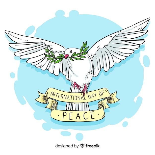 Jour de paix dessiné à la main avec une colombe Vecteur gratuit