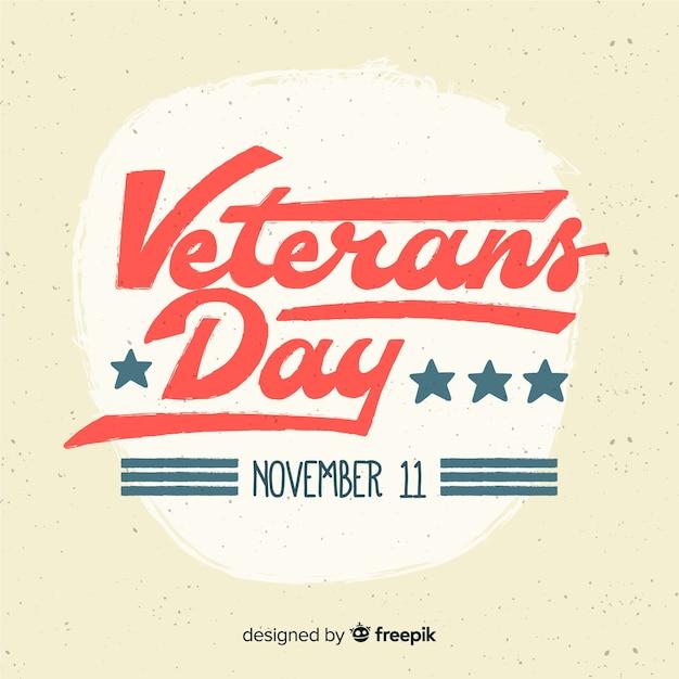 Journée des anciens combattants avec lettrage rouge et bleu Vecteur gratuit