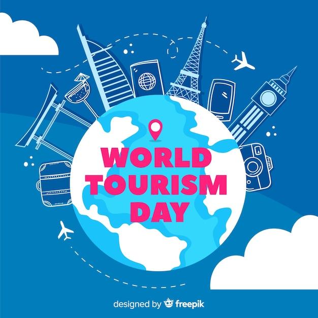 Journée du tourisme dessiné à la main attractions touristiques et accessoires Vecteur gratuit