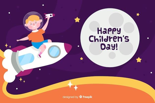 Journée des enfants plats avec l'enfant sur une fusée spatiale Vecteur gratuit