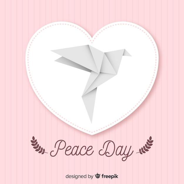 Journée internationale de la paix avec la colombe origami Vecteur gratuit
