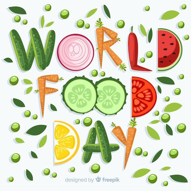 Journée mondiale de l'alimentation écrite avec des légumes Vecteur gratuit