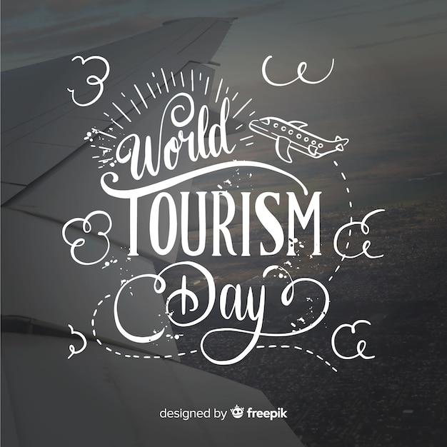 Journée mondiale du tourisme avec typograhy Vecteur gratuit