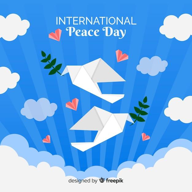 Journée de la paix avec la colombe origami Vecteur gratuit