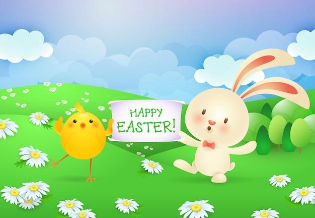 Joyeuses pâques, lettrage sur la bannière tenue par le lapin et le poussin Vecteur gratuit