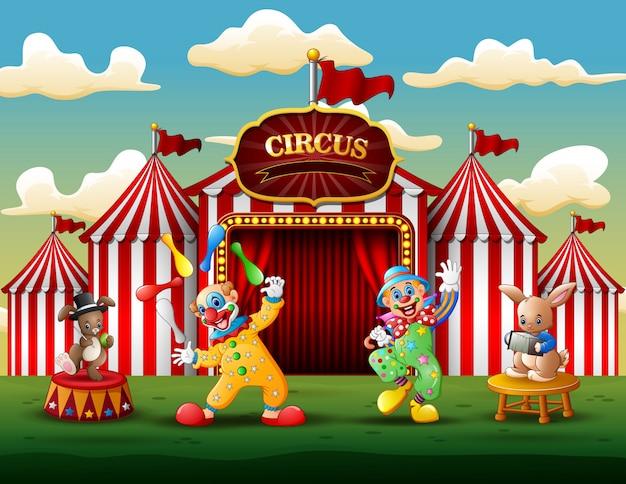 Joyeux clowns et lapins sur l'arène Vecteur Premium