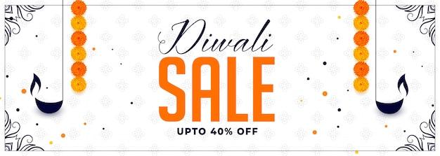 Joyeux diwali vente bannière avec diya et fleur de souci Vecteur gratuit