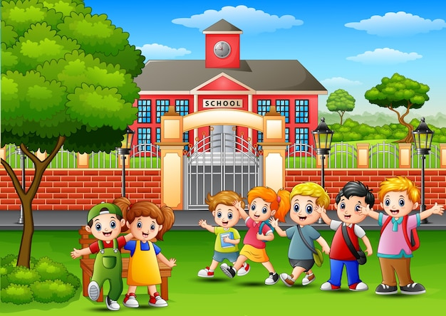 Joyeux écoliers debout devant le bâtiment de l'école Vecteur Premium