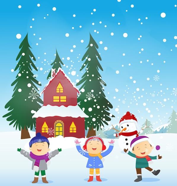 Joyeux enfants jouant à l'extérieur en hiver Vecteur Premium