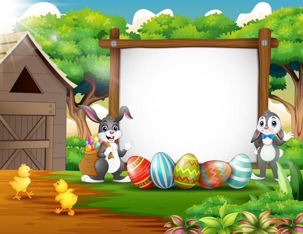 Joyeux lapin et poulet avec fond de pâques Vecteur Premium