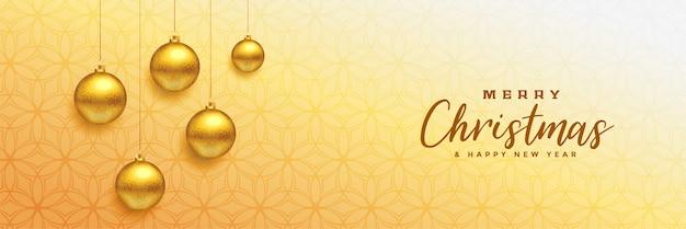 Joyeux Noël Belle Bannière Avec Des Boules De Noël Dorées Vecteur gratuit
