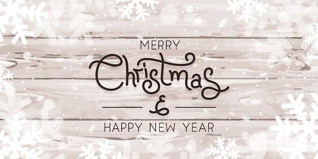 Joyeux Noël Et Bonne Année Flocons De Neige Sur La Texture En Bois Vecteur Premium