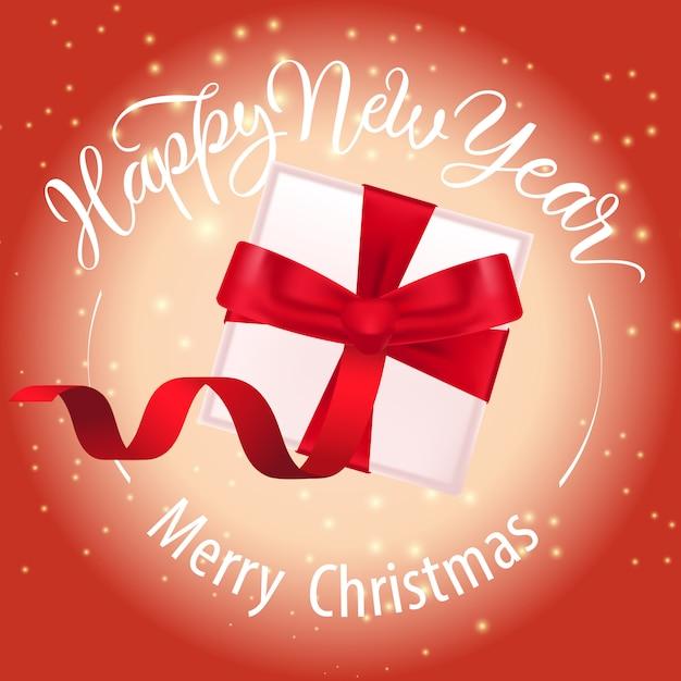 Joyeux noël, bonne année lettrage et coffret cadeau Vecteur gratuit