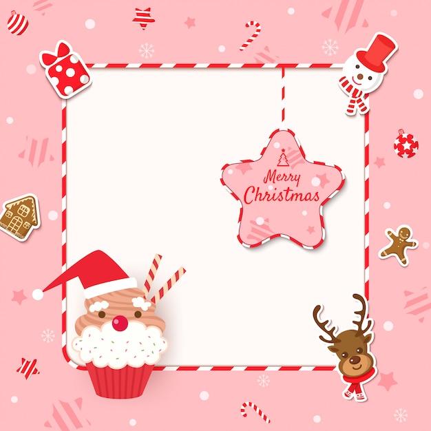 Joyeux noël cadre avec cupcake et cookies aux ornements sur fond rose. Vecteur Premium