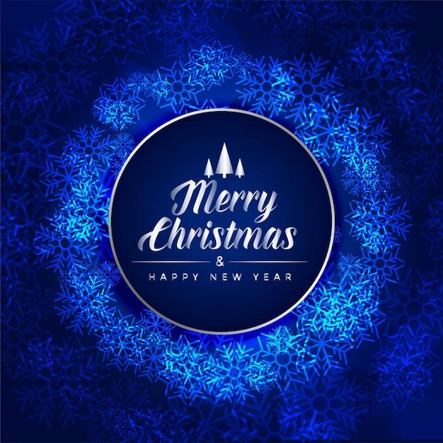 Joyeux noël carte bleue du festival faite avec des flocons de neige Vecteur gratuit