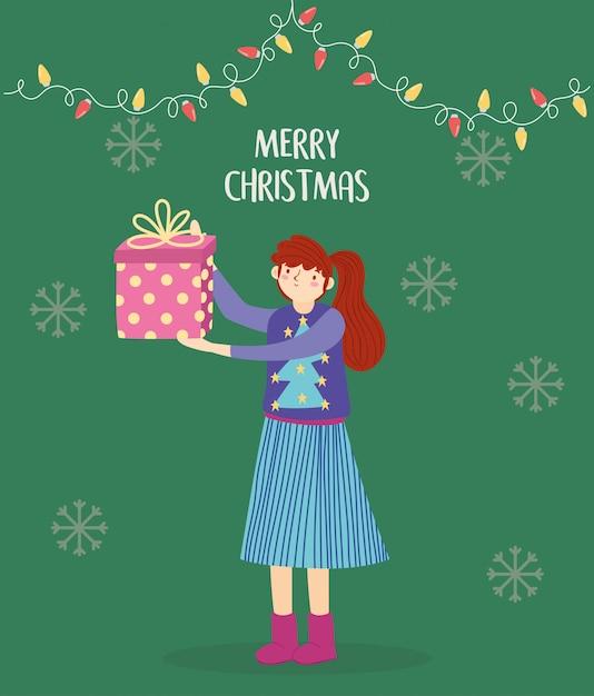 Joyeux Noël Femme Avec Chandail Laid Tenant Cadeau Lumières Décoration Vecteur Premium