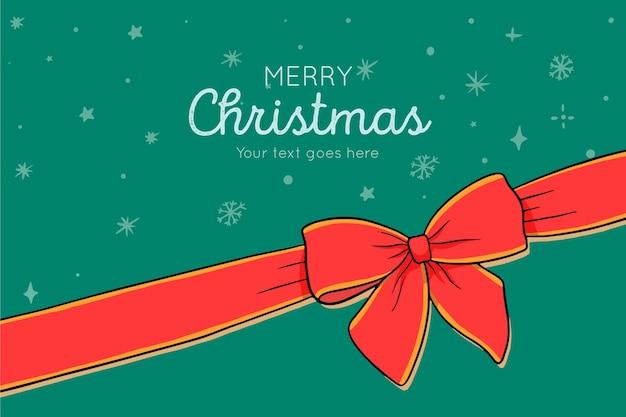 Joyeux Noel Avec Ruban Vecteur gratuit