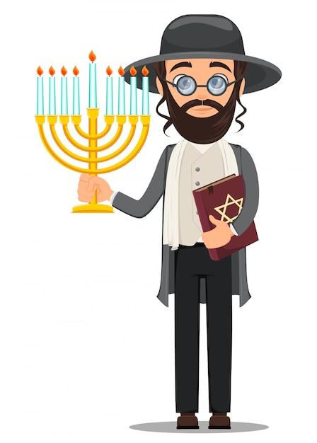 Juif en costume traditionnel avec bible et menorah Vecteur Premium