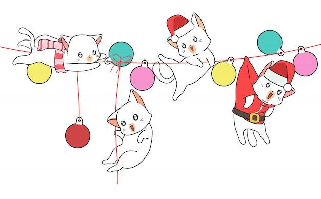 Kawaii chats sur la toile avec des balles Vecteur Premium