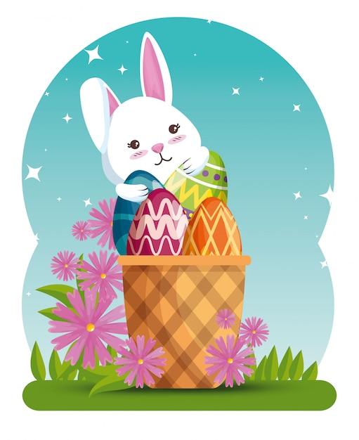 Lapin à la décoration d'oeufs dans le panier et fleurs Vecteur gratuit
