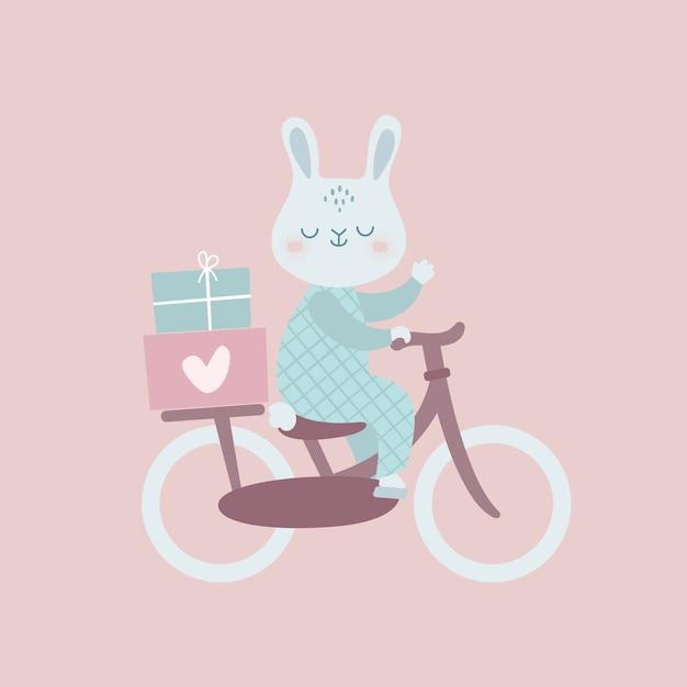 Lapin drôle à vélo avec des cadeaux Vecteur Premium